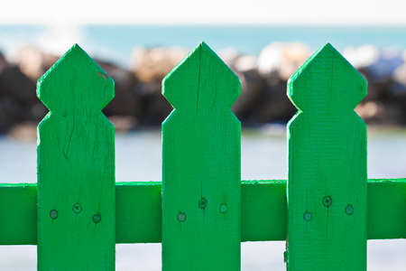 Detail of a green wooden fence