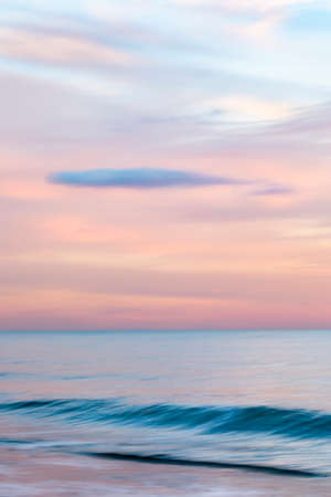 abstract landscape of sea. texture water, sky and sand in blurry motion in tropical sunset colors Banque d'images