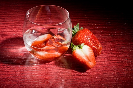 photo of strawberries on ice on red table Stock Photo - 8947187