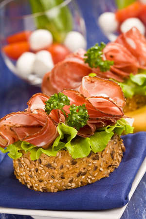 delicious salami and lettuce sandwich on yellow cloth with parsley Stock Photo - 9009292