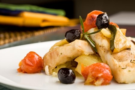 photo of delicious baked cod with olives and tomatoes Stock Photo