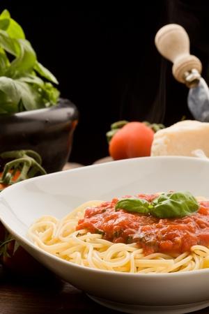 photo of italian spaghetti with tomatoe sauce and their ingredients arround Stock Photo - 9099476