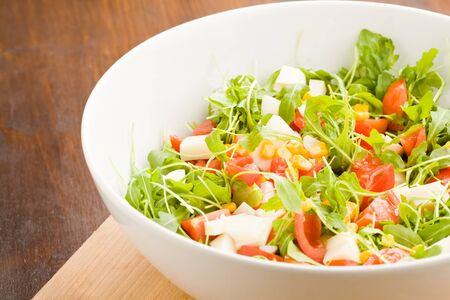 mais: photo of delicious rocket salad with tomatoes and mais