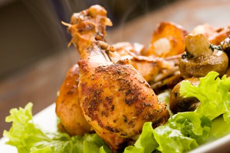 photo of roasted smoking hot chicken with mushrooms and lettuce Stock Photo - 9099794