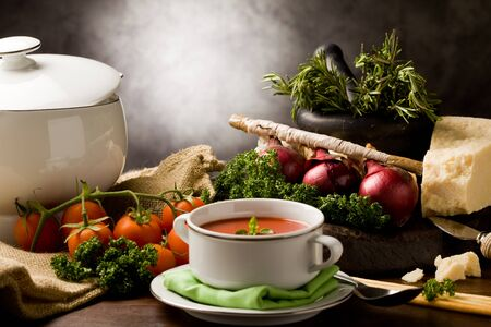 photo ofo delicious tomato soup with vegetables on wooden table Stock Photo - 9099941