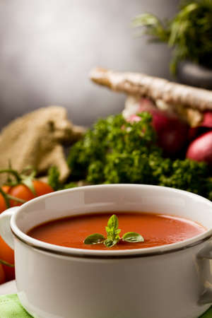 photo ofo delicious tomato soup with vegetables on wooden table Stock Photo - 9098995