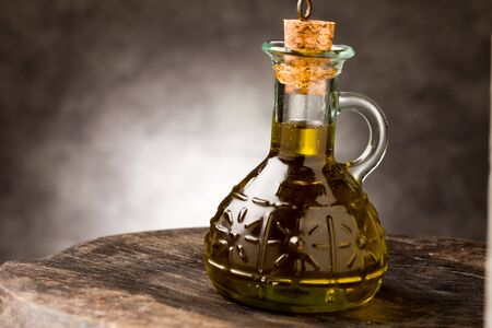 photo of delicious extra virgin olive oil inside a glass bottle Stock Photo