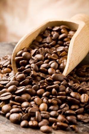 photo of brown delicious roasted coffee beans on wooden table Stock Photo - 9194309
