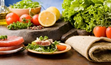 photo of sliced Tuna Steak with arugula salad and ingredients arround Stock Photo - 9194449