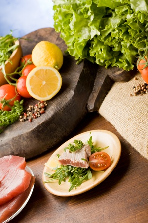 photo of sliced Tuna Steak with arugula salad and ingredients arround Stock Photo - 9194365