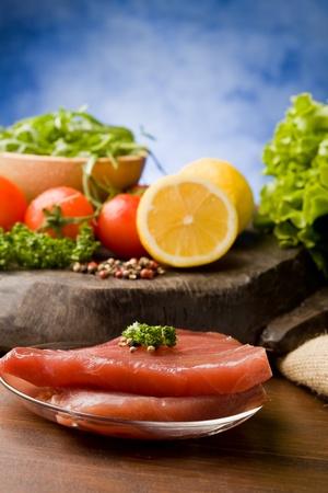 photo of raw tuna steak with ingredients arround  Stock Photo - 9194433