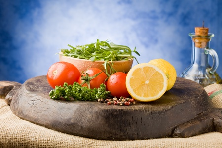 photo of different vegetables on wooden chopping board ready for cooking Stock Photo - 9194450
