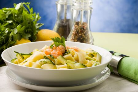 pasta fork: photo of delicious italian pasta with zucchini and shrimps