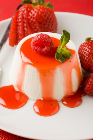 photo of italian panna cotta dessert with strawberry sirup and mint leaf Stock Photo - 9236569
