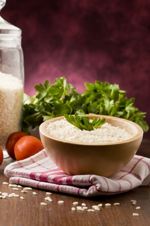 photo of ingredients for risotto with parsley on wooden table photo