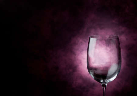 pink wine: Photo of Red Wine inside a wine glass with abstract background