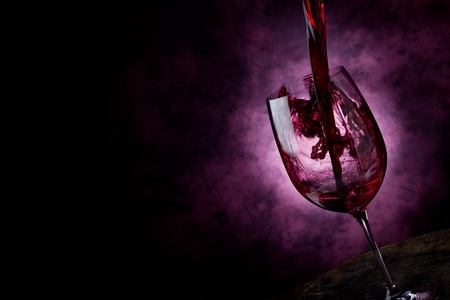 Photo of Red Wine inside a wine glass with abstract background photo