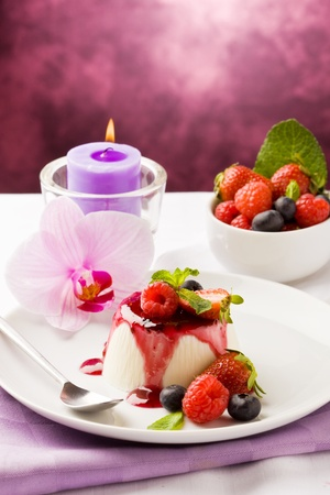 photo of delicious panna cotta dessert with berries  photo