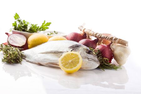 bream: photo of bream with different ingredients on white background