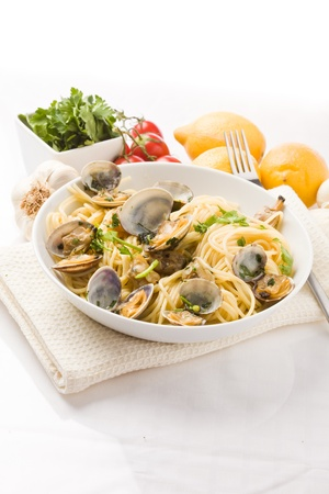 phto of delicious pasta with clams on white background Stock Photo