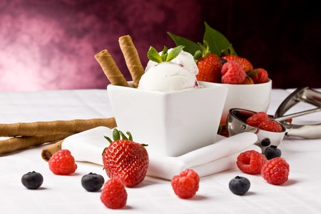 photo of delicious ice cream with berries on the table  photo