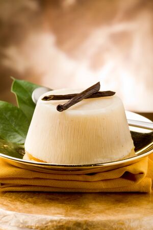 photo of delicious vanilla orange pudding on golden plate