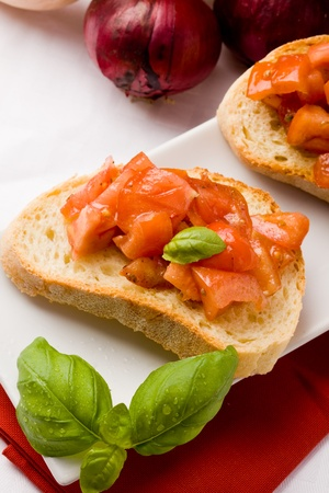 olive  oil: photo of delicious italian bruschetta with basil and ingredients Stock Photo