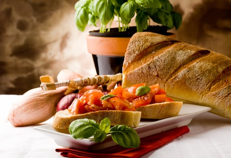 bruschetta: photo of delicious italian bruschetta with basil and ingredients Stock Photo