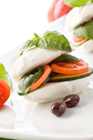 photo of delicious stuffed mozzarella sandwich with oil and basil  photo