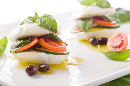 starter: photo of delicious stuffed mozzarella sandwich with oil and basil  Stock Photo