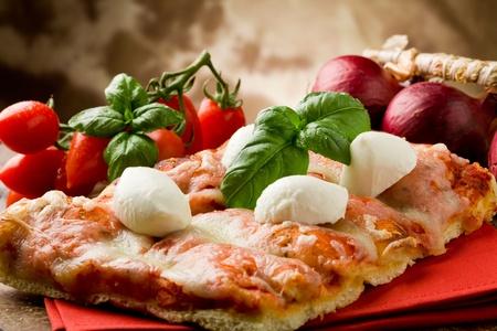 delicious slice of pizza with buffalo mozzarella on wooden table photo