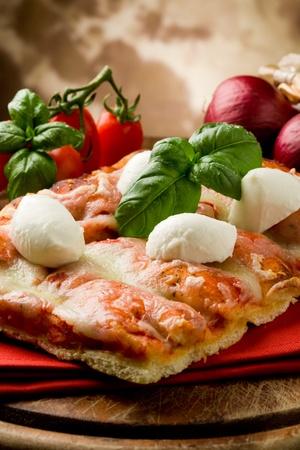 delicious slice of pizza with buffalo mozzarella on wooden table Stock Photo - 9456495