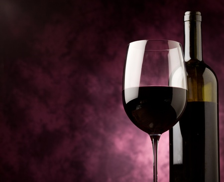 photo of mature red wine with bottle in front of rural background Stock Photo - 9456386