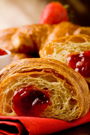 delicious golden croissants filled with strawberry marmelade Stock Photo - 9512764