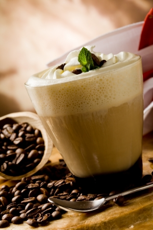 photo of delicious coffee beverage with whipped cream and coffee beans Stock Photo