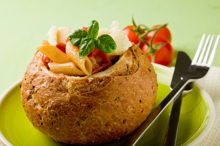 delicious multi grain bread stuffed with pasta on green plate photo