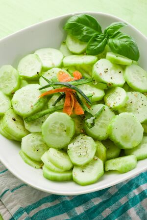 photo of delicious cucumber salad on green white napkin Stock Photo