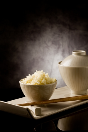 basmati: delicious asian rice plate with chopsticks on glass table
