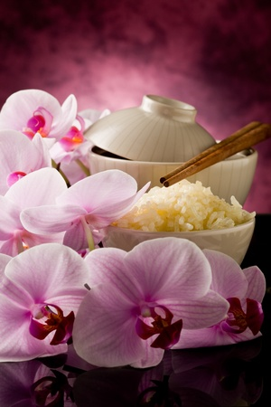 delicious asian rice dish with orchid flowers around photo