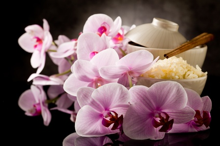 delicious asian rice dish with orchid flowers around