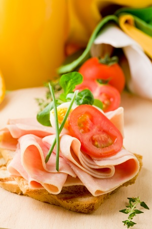 phto of delicious toast with ham on wooden table with orange juice photo