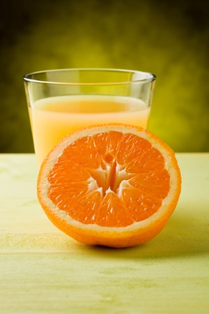 fresh orange juice inside a glass on wooden table  Stockfoto