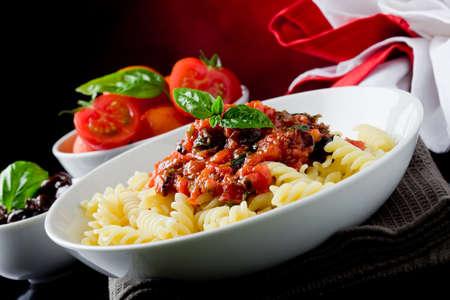 delicious italian pasta with tomato sauce and basil  Stock Photo - 9703705