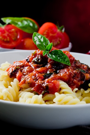 delicious italian pasta with tomato sauce and basil