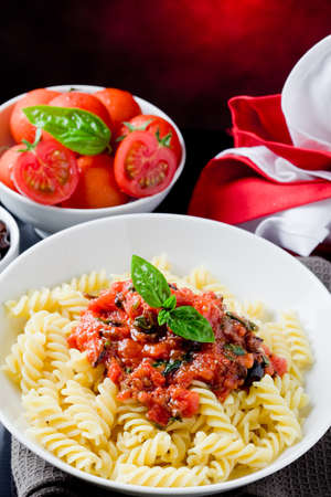 delicious italian pasta with tomato sauce and basil  photo