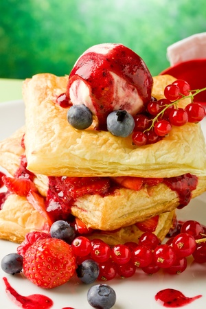 photo of delicious puff pastry with berries and ice cream  photo
