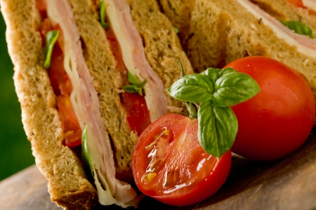 delicious sandwich with cheese and ham on wooden table Stock Photo