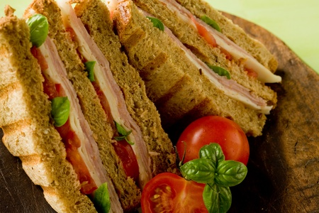 delicious sandwich with cheese and ham on wooden table Stock Photo - 9960306