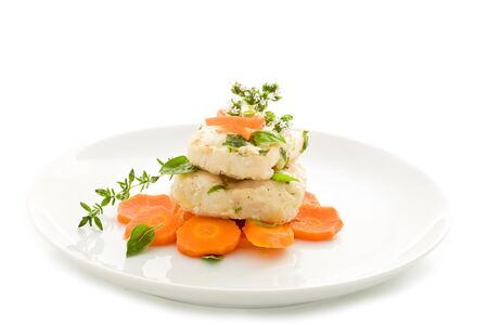 delicious cod over carrots on isolated white background photo