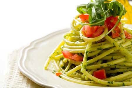 mediterranean food:  delicious pasta with arugula pesto and cherry tomatoes